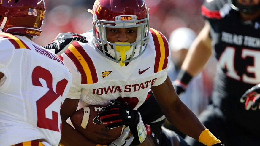 Iowa State's Aaron Wimberly (2) looks for more yards against Texas Tech during their NCAA college football game in Lubbock, Texas, Saturday, Oct. 12, 2013. (AP Photo/Lubbock Avalanche-Journal, Stephen Spillman)