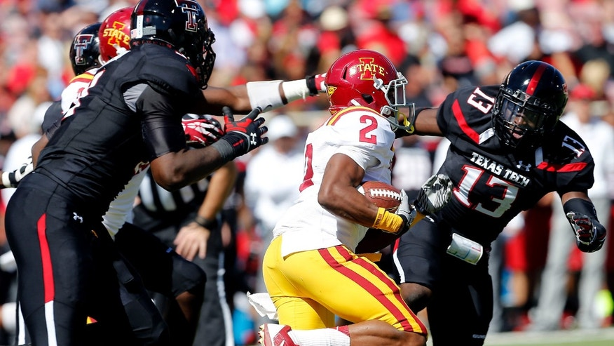 Iowa State's Aaron Wimberly (2) looks to get away from Texas Tech's Branden Jackson (9) and Sam Eguavoen (13) during their NCAA college football game in Lubbock, Texas, Saturday, Oct. 12, 2013. (AP Photo/Lubbock Avalanche-Journal, Stephen Spillman)