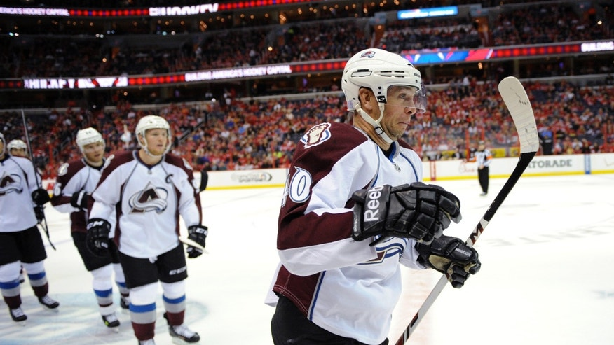 Colorado Avalanche left wing Alex Tanguay skates to the bench after he scored a goal during the first period an NHL hockey game against the Washington Capitals, Saturday, Oct. 12, 2013, in Washington. (AP Photo/Nick Wass)
