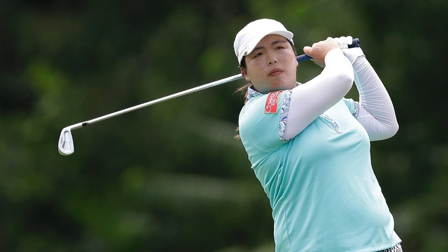China's Shanshan Feng watches her approach during the final round at the Malaysian LGPA event in Kuala Lumpur, Sunday, Oct. 13, 2013. (AP Photo/Mark Baker)