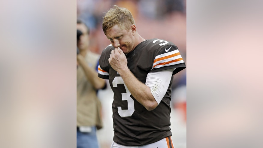 Cleveland Browns quarterback Brandon Weeden walks off the field after a 31-17 loss to the Detroit Lions in an NFL football game Sunday, Oct. 13, 2013, in Cleveland. (AP Photo/Tony Dejak)