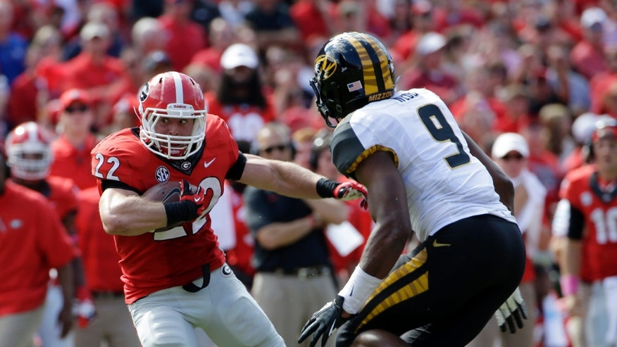 Georgia running back Brendan Douglas (22) tries to get past Missouri's Eddie Printz during the second half of an NCAA college football game Saturday, Oct. 12, 2013 in Athens, Ga. Missouri won 41-26. (AP Photo/John Bazemore)