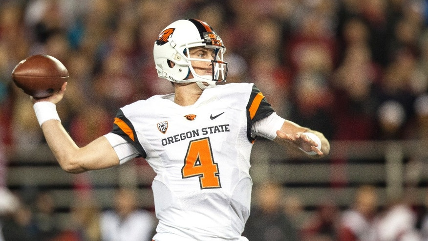 Oregon State quarterback Sean Mannion (4) attempts a pass during the first quarter of an NCAA college football game against Washington State on Saturday, Oct. 12, 2013, at Martin Stadium in Pullman, Wash. (AP Photo/Dean Hare)