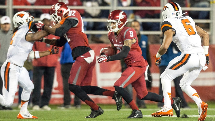 Washington State wide receiver Gabe Marks (9) cuts inside Oregon State cornerback Sean Martin (6) follows his blocker, wide receiver Bobby Ratliff (82), after catching a Connor Halliday pass during the first quarter of an NCAA college football game Saturday, Oct. 12, 2013, at Martin Stadium in Pullman, Wash. (AP Photo/Dean Hare)