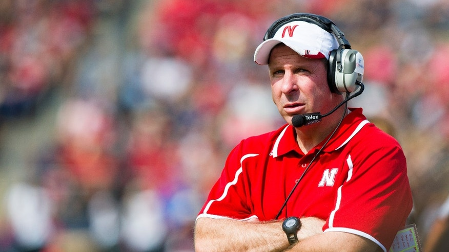 Nebraska head coach Bo Pelini watches a replay on the stadium's screen during the second half of an NCAA college football game against Purdue Saturday, Oct. 12, 2013, in West Lafayette, Ind. Nebraska won 44-7. (AP Photo/Doug McSchooler)