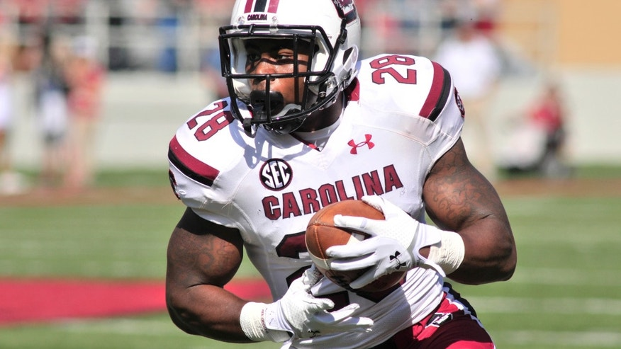 South Carolina running back Mike Davis carries the ball during the first half of an NCAA college football game against Arkansa in Fayetteville, Ark., Saturday, Oct. 12, 2013. Davis rushed for 128 yards on 19 carries in South Carolina's 52-7 win. (AP Photo/April L Brown)