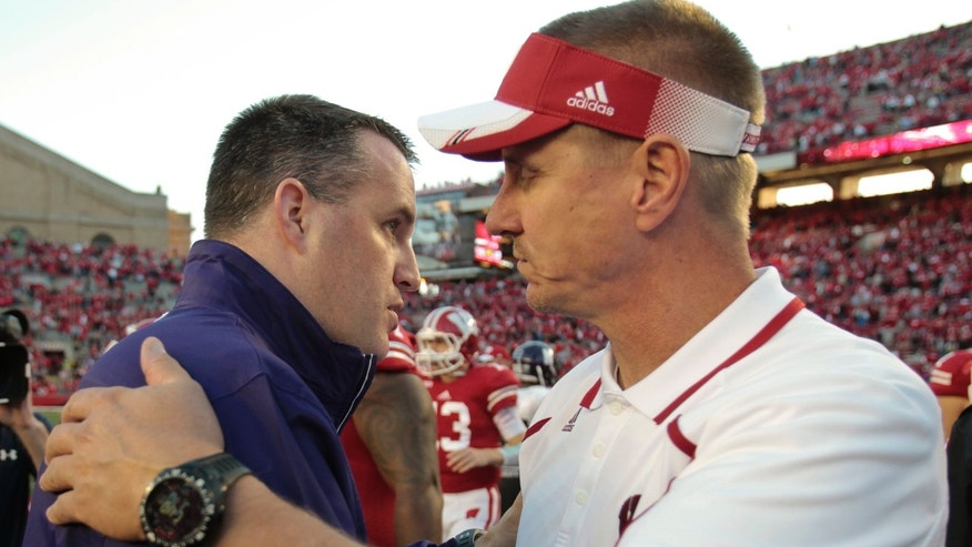 Northwestern coach Pat Fitzgerald, left, and Wisconsin coach Gary Andersen greet each ofter Wisconsin beat Northwestern 35-6 in an NCAA college football game in Madison, Wis., Saturday, Oct. 12, 2013.