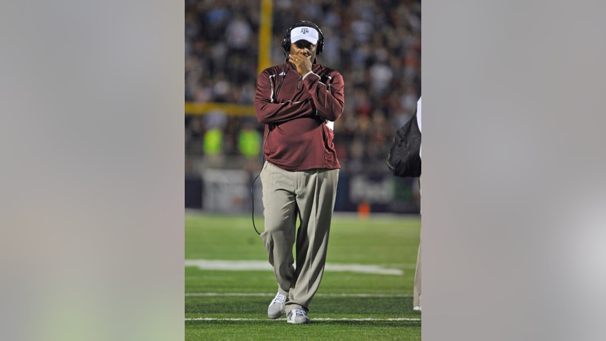 Texas A&M coach Kevin Sumlin during a timeout during the fourth quarter of an NCAA college football game on Saturday, Oct. 12, 2013, in Oxford, MS. #9 Texas A&M won 41-38. (AP Photo/ The Daily Mississippian, Austin McAfee)