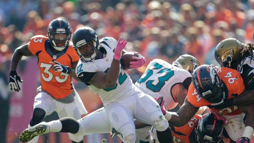 Jacksonville Jaguars running back Maurice Jones-Drew (32) turns the ball up field against the Denver Broncos in the first quarter of an NFL football game, Sunday, Oct. 13, 2013, in Denver. (AP Photo/Joe Mahoney)