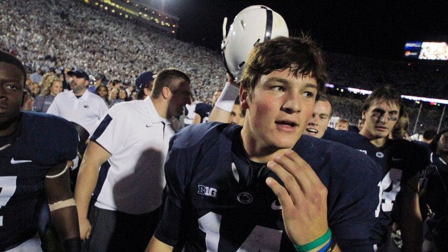 Penn State quarterback Christian Hackenberg (14) celebrates with teammates Penn State beat Michigan 43-40 during an NCAA college football game in State College, Pa., Saturday, Oct. 12, 2013. (AP Photo/Gene J. Puskar)