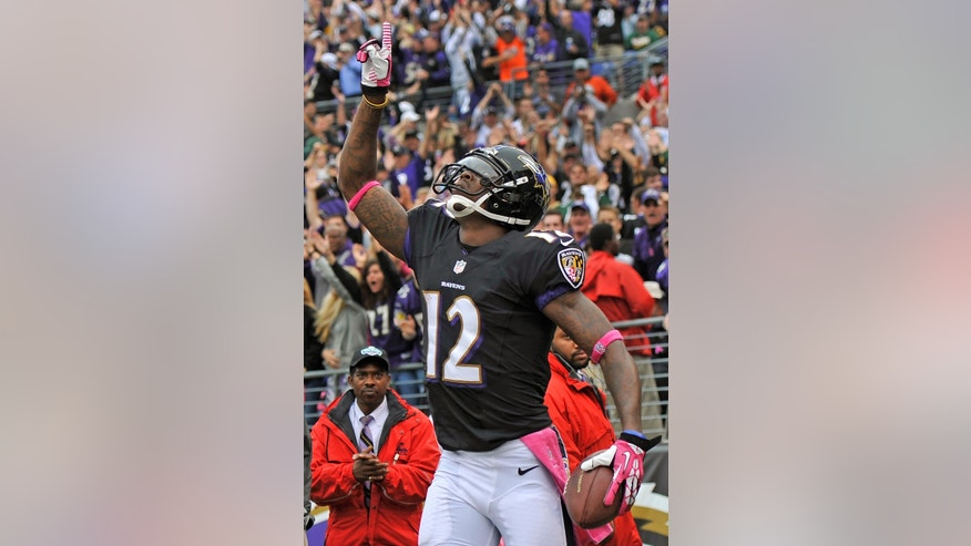 Baltimore Ravens wide receiver Jacoby Jones celebrates his touchdown catch during the second half of an NFL football game against the Green Bay Packers in Baltimore, Sunday, Oct. 13, 2013. (AP Photo/Gail Burton)