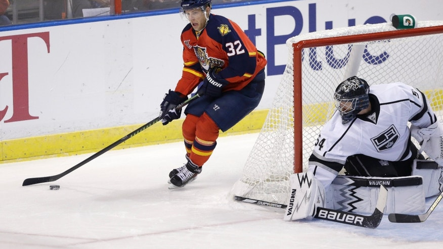 Florida Panthers right wing Kris Versteeg (32) goes behind Los Angeles Kings goalie Ben Scrivens (54) during the first period of an NHL hockey game, Sunday, Oct. 13, 2013, in  Sunrise, Fla. (AP Photo/Wilfredo Lee)