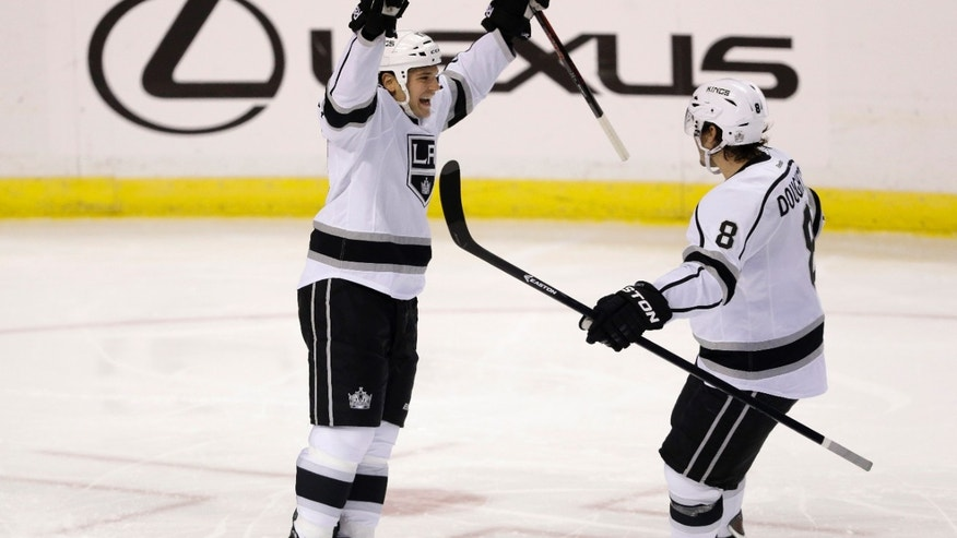 Los Angeles Kings left wing Daniel Carcillo, left, celebrates with defenseman Drew Doughty (8) after Carcillo scored a goal during the second period of an NHL hockey game against the Florida Panthers, Sunday, Oct. 13, 2013, in  Sunrise, Fla. (AP Photo/Wilfredo Lee)