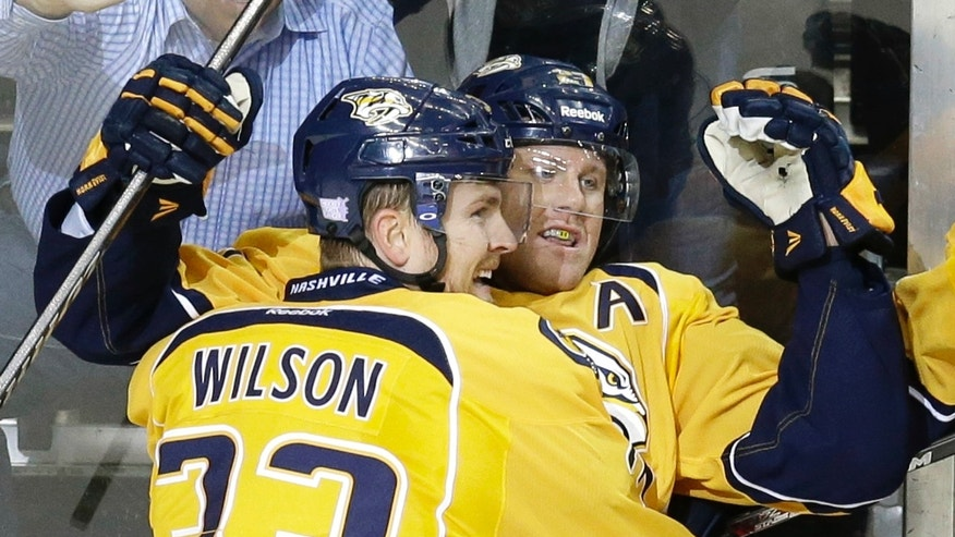 Nashville Predators forward Patric Hornqvist, of Sweden, right, celebrates with Colin Wilson (33) after Hornqvist scored against the New York Islanders during the second period of an NHL hockey game on Saturday, Oct. 12, 2013, in Nashville, Tenn. (AP Photo/Mark Humphrey)