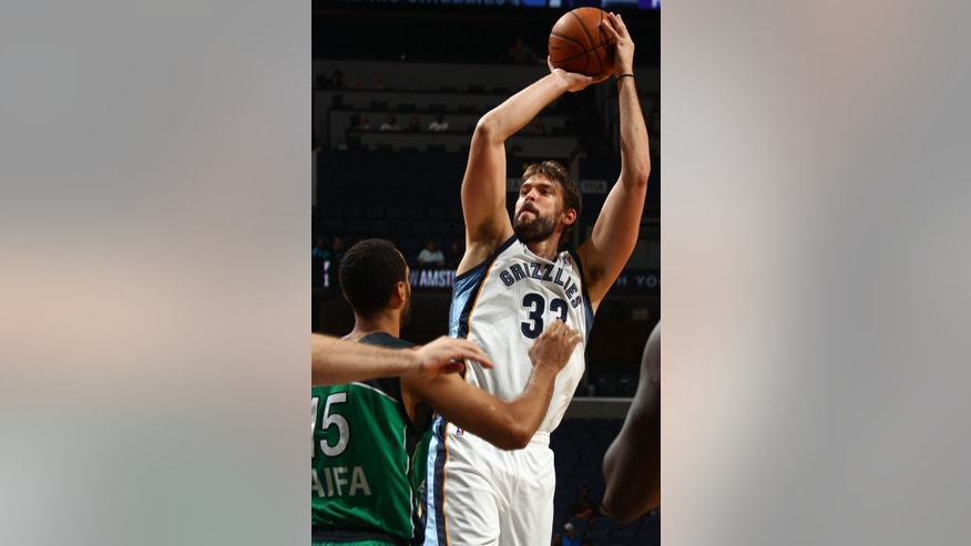 Memphis Grizzlies center Marc Gasol (33), of Spain, shoots while defended by Maccabi Haifa forward Brian Randle (15) in the first half of an NBA preseason basketball game on Sunday, Oct. 13, 2013, in Memphis, Tenn. (AP Photo/Nikki Boertman)