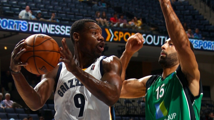 Memphis Grizzlies guard Tony Allen (9) looks for help while defended by Maccabi Haifa forward Brian Randle (15) in the first half of an NBA preseason basketball game on Sunday, Oct. 13, 2013, in Memphis, Tenn. (AP Photo/Nikki Boertman)