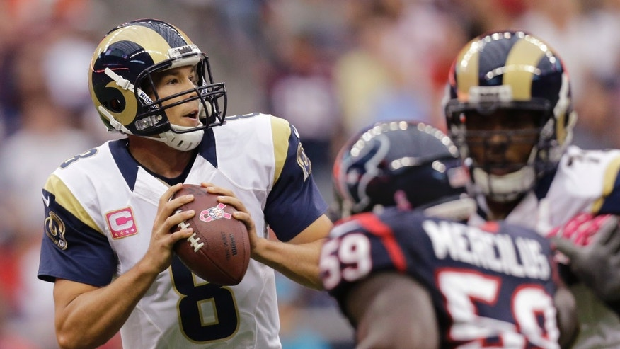 St. Louis Rams quarterback Sam Bradford (8) looks to pass against the Houston Texans during the second quarter of an NFL football game Sunday, Oct. 13, 2013, in Houston, Texas. (AP Photo/Eric Gay)