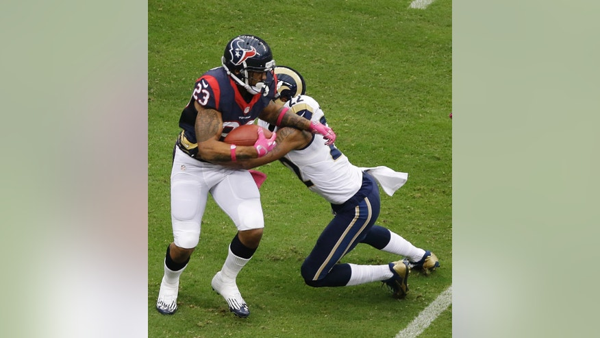 Houston Texans running back Arian Foster (23) is tackled by St. Louis Rams' Trumaine Johnson (22) during the first quarter of an NFL football game Sunday, Oct. 13, 2013, in Houston, Texas. (AP Photo/Pat Sullivan)