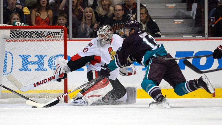 Anaheim Ducks center Nick Bonino, right, tires to get a shot in on Ottawa Senators goalie Robin Lehner, of Sweden, during the first period of their NHL hockey game, Sunday, Oct. 13, 2013, in Anaheim, Calif. (AP Photo/Mark J. Terrill)