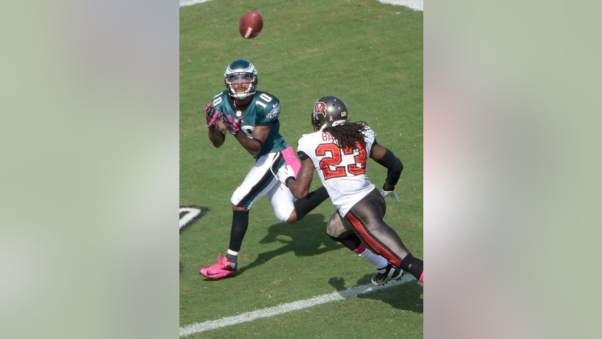 Philadelphia Eagles wide receiver DeSean Jackson (10) makes a touchdown catch in the end zone in front of Tampa Bay Buccaneers strong safety Mark Barron (23) during the fourth quarter of an NFL football game in Tampa, Fla., Sunday, Oct. 13, 2013. The Eagles won 31-20.(AP Photo/Phelan M. Ebenhack)