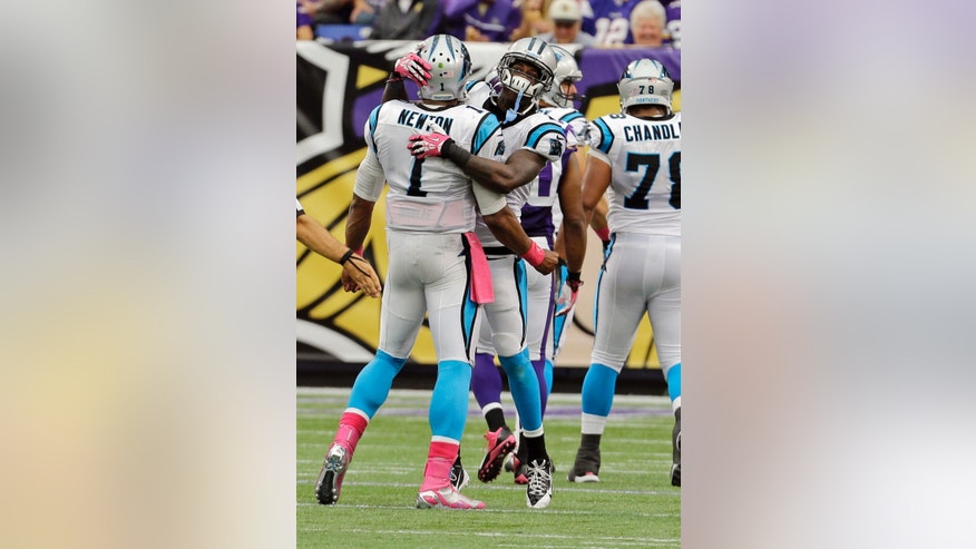 Carolina Panthers wide receiver Brandon LaFell, right, and quarterback Cam Newton celebrate a a 79-yard pass for a touchdown  from Newton to LaFell during the second half of an NFL football game against the Minnesota Vikings in Minneapolis, Sunday, Oct. 13, 2013. (AP Photo/Ann Heisenfelt)