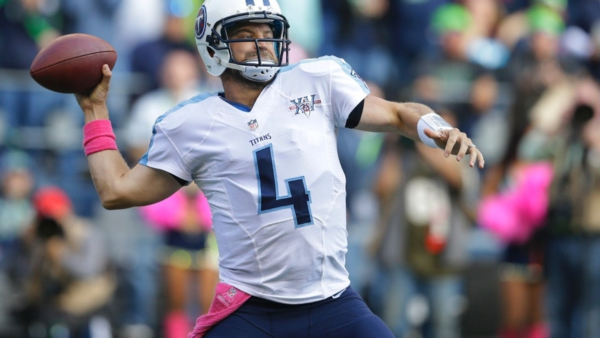 Tennessee Titans quarterback Ryan Fitzpatrick passes against the Seattle Seahawks in the second half of an NFL football game, Sunday, Oct. 13, 2013, in Seattle. (AP Photo/Elaine Thompson)