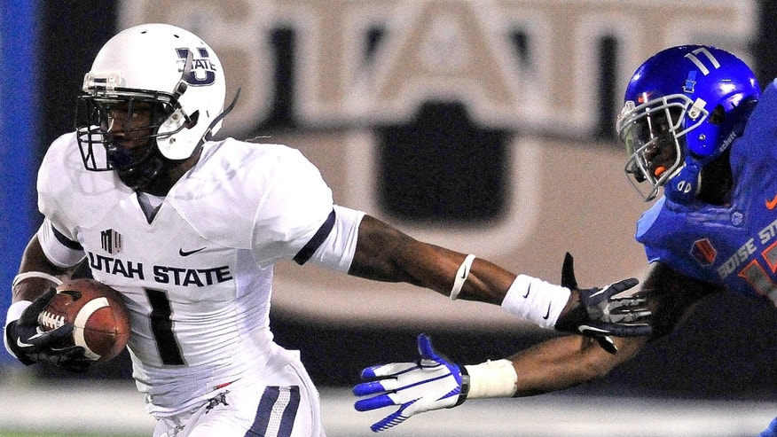 Utah State's Nevin Lawson (1) breaks free from Boise State's Geraldo Boldewijn (17) after Lawson intercepted a pass intended for Boldewijn during their game, Saturday, Oct. 12, 2013, in Logan, Utah. (AP Photo/Herald Journal, John Zsiray)
