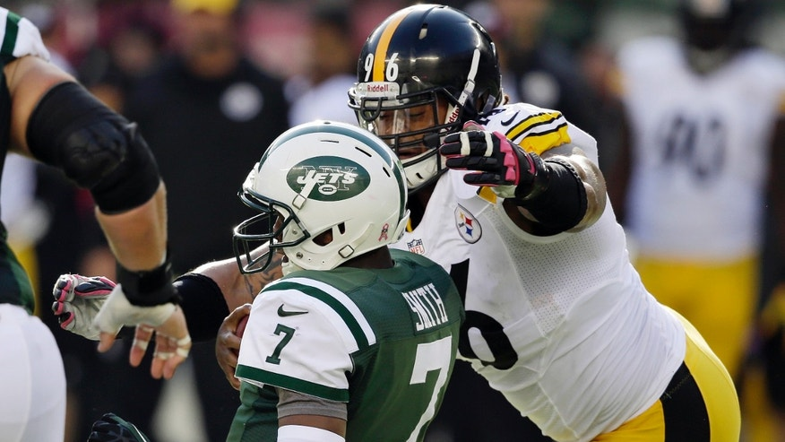Pittsburgh Steelers' Ziggy Hood (96) tackles New York Jets' Geno Smith (7) during the second half of an NFL football game on Sunday, Oct. 13, 2013, in East Rutherford, N.J. The Steelers won 19-6. (AP Photo/Seth Wenig)