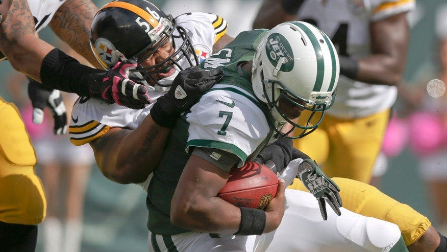 Pittsburgh Steelers outside linebacker LaMarr Woodley (56) sacks New York Jets quarterback Geno Smith (7) during the first half of an NFL football game Sunday, Oct. 13, 2013, in East Rutherford, N.J.  (AP Photo/Kathy Willens)