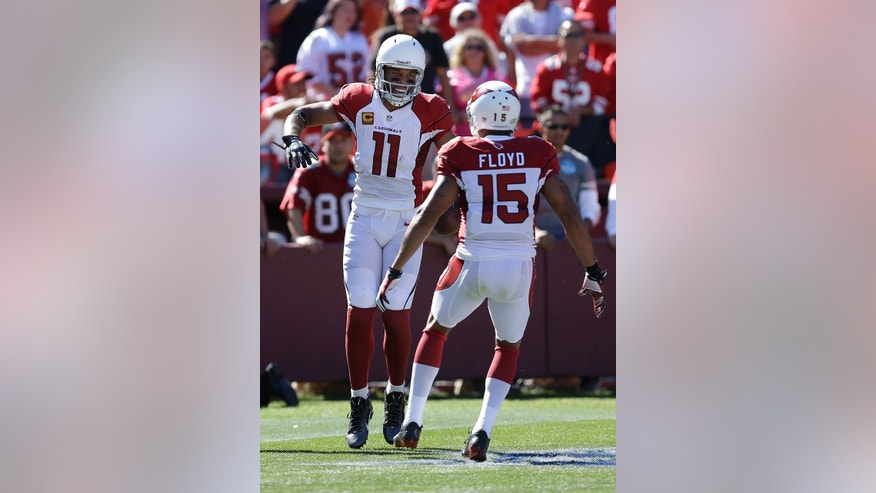 Arizona Cardinals wide receiver Larry Fitzgerald (11) celebrates after scoring on a 75-yard touchdown reception with wide receiver Michael Floyd (15) during the first quarter of an NFL football game against the San Francisco 49ers in San Francisco, Sunday, Oct. 13, 2013. (AP Photo/Ben Margot)