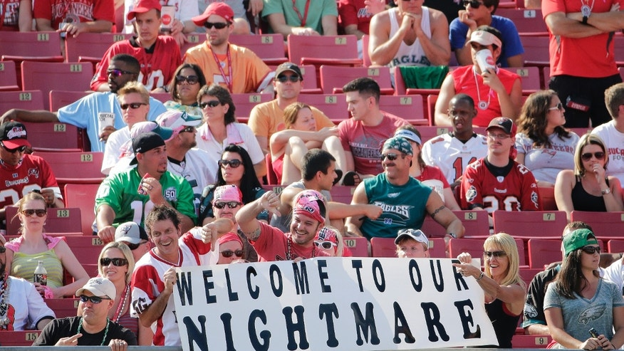 Tampa Bay Buccaneers fans show their displeasure with the team during the fourth quarter of an NFL football game against the Philadelphia Eagles Sunday, Oct. 13, 2013, in Tampa, Fla. The Eagles defeated the Buccaneers 31-20. (AP Photo/Chris O'Meara)
