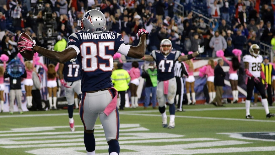 New England Patriots wide receiver Kenbrell Thompkins (85) celebrates his winning touchdown catch against New Orleans Saints  in the fourth quarter of an NFL football game Sunday, Oct.13, 2013, in Foxborough, Mass. The Patriots won 30-27. (AP Photo/Stephan Savoia)