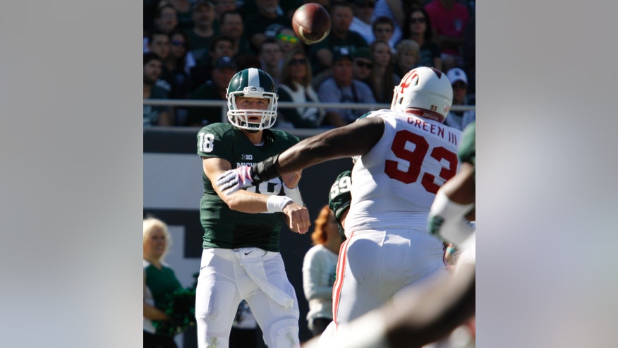 Michigan State quarterback Connor Cook (18) throws a pass over Indiana's Ralphael Green during the first quarter of an NCAA college football game, Saturday, Oct. 12, 2013, in East Lansing, Mich. Michigan State won 42-28. (AP Photo/Al Goldis)