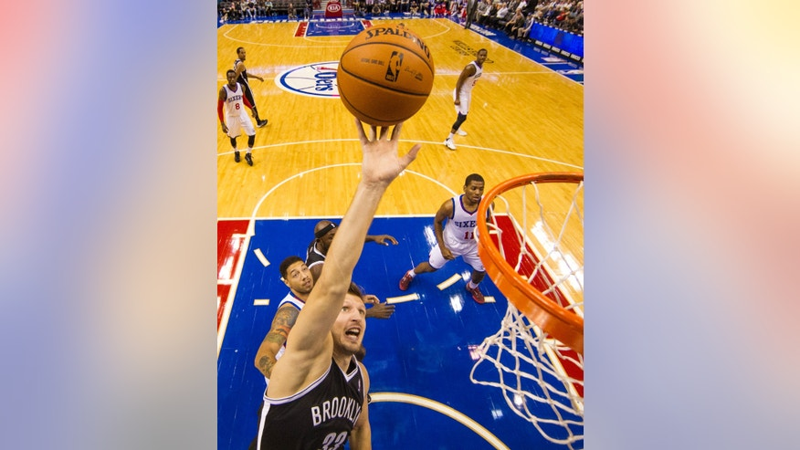 Brooklyn Nets' Mirza Teletovic of Bosnia puts up the shot during the first quarter of a preseason NBA basketball game against the Philadelphia 76ers, Monday, Oct. 14, 2013, in Philadelphia.  (AP Photo/Chris Szagola)