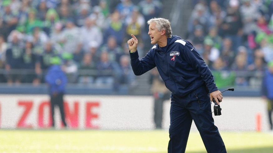 Seattle Seahawks head coach Pete Carroll calls to his team in the first half of an NFL football game against the Tennessee Titans, Sunday, Oct. 13, 2013, in Seattle. The Seahawks defeated the Titans, 20-13. (AP Photo/Elaine Thompson)