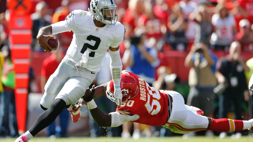 Oakland Raiders quarterback Terrelle Pryor (2) avoids Kansas City Chiefs outside linebacker Justin Houston (50) during the first half of an NFL football game at Arrowhead Stadium in Kansas City, Mo., Sunday, Oct. 13, 2013. (AP Photo/Ed Zurga)