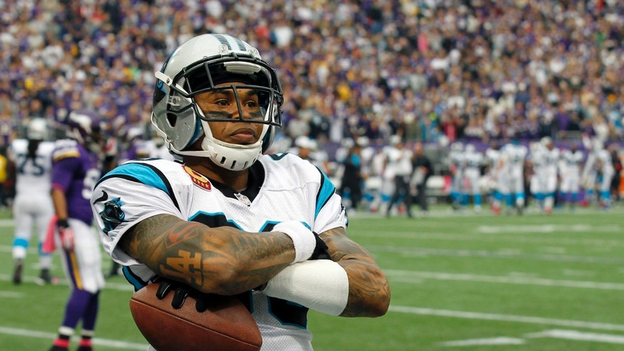 Carolina Panthers wide receiver Steve Smith crosses his arms after a touchdown catch against the Minnesota Vikings during the first half of an NFL football game in Minneapolis, Sunday, Oct. 13, 2013. (AP Photo/Ann Heisenfelt)