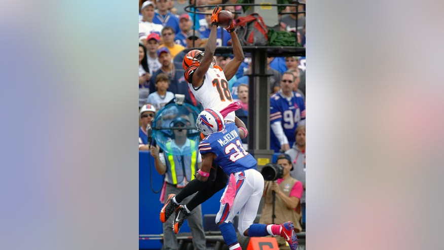 Cincinnati Bengals wide receiver A.J. Green (18) goes up for a touchdown catch over Buffalo Bills cornerback Leodis McKelvin (21) in the first quarter of an NFL football game on Sunday, Oct. 13, 2013, in Orchard Park, N.Y. (AP Photo/Bill Wippert)