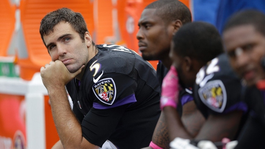 Baltimore Ravens quarterback Joe Flacco sits on the bench watching the replay screen during the first half of a NFL football game against the Green Bay Packers in Baltimore, Sunday, Oct. 13, 2013. The Ravens were defeated by the PackerS 19-17.(AP Photo/Patrick Semansky)