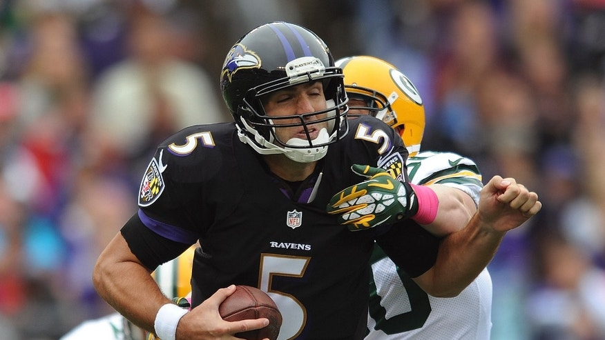 Baltimore Ravens quarterback Joe Flacco (5) is sacked by Green Bay Packers inside linebacker A.J. Hawk during the first half of an NFL football game in Baltimore, Sunday, Oct. 13, 2013. (AP Photo/Gail Burton)
