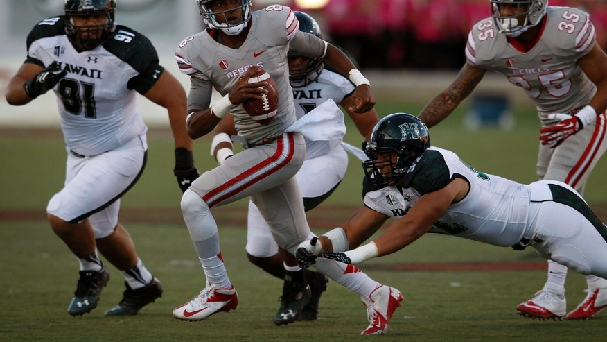UNLV quarterback Caleb Herring runs for yardage during an NCAA college football game against Hawaii in Las Vegas, Saturday, Oct. 12, 2013. (AP Photo/Las Vegas Review-Journal, John Locher)  LOCAL TV OUT; LOCAL INTERNET OUT; LAS VEGAS SUN OUT