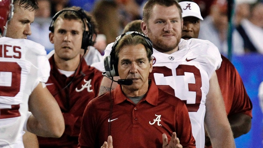 Alabama coach Nick Saban gestures as he talks with assistants in the booth following a play against Kentucky in an NCAA college football game in Lexington, Ky., Saturday, Oct. 12, 2013. No. 1 Alabama beat Kentucky 48-7. (AP Photo/Garry Jones)