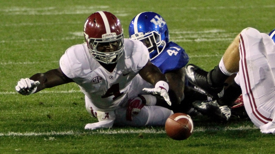 Alabama running back T.J. Yeldon (4) loses the football inside the 5-yard line against Kentucky in an NCAA college football game in Lexington, Ky., Saturday, Oct. 12, 2013. Kentucky recovered the ball at the 1. (AP Photo/Garry Jones)