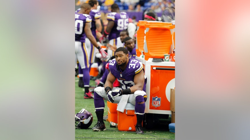 Minnesota Vikings strong safety Jamarca Sanford sits on the bench in the closing minutes of a 35-10 loss to the Panthers in an NFL football game in Minneapolis, Sunday, Oct. 13, 2013. (AP Photo/Ann Heisenfelt)