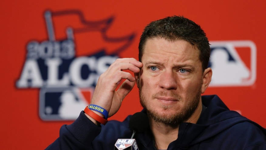 Boston Red Sox starting pitcher Jake Peavy listens to a question during a news conference before Game 3 of the American League baseball championship series against the Detroit Tigers Tuesday, Oct. 15, 2013, in Detroit. Peavy will be the Game 4 starting pitcher for Boston. (AP Photo/Carlos Osorio)