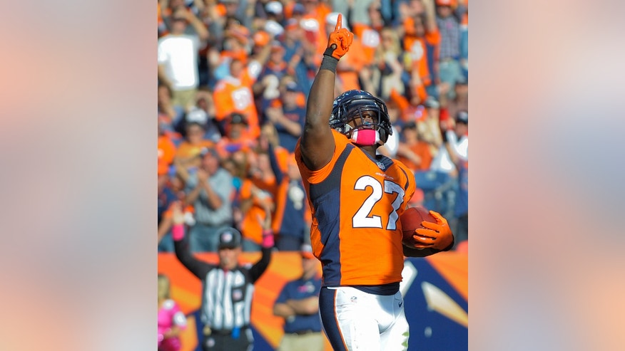 Denver Broncos running back Knowshon Moreno (27) reacts after scoring a touchdown against the Jacksonville Jaguars in the third quarter of an NFL football game, Sunday, Oct. 13, 2013, in Denver. (AP Photo/Jack Dempsey)