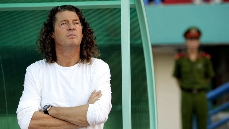 FILE - A Monday, July 16, 2007 photo from files showing The United Arab Emirates (UAE)'s coach Bruno Metsu listening to the national anthem of Qatar before the AFC Asian Cup 2007 Group B soccer match between UAE and Qatar at the Army Stadium in Ho Chi Minh City, Vietnam. Metsu, who coached Senegal in a remarkable run to the 2002 World Cup quarterfinals, has died. He was 59. Metsu spent his last years as a coach in the Middle East with spells in charge of the United Arab Emirates and Qatar national teams, as well as club sides Al-Gharafa in Qatar and Al Wasl in the UAE, where he replaced Diego Maradona.(AP Photo/Eugene Hoshiko, File)