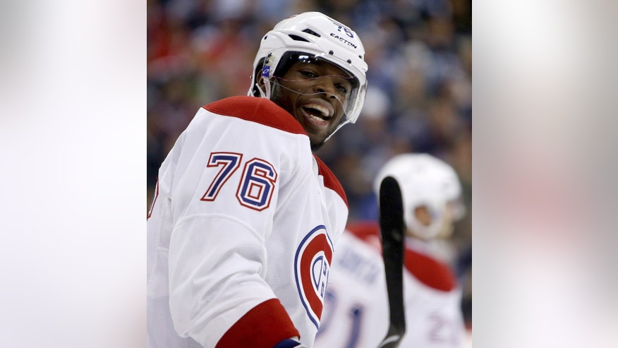 Montreal Canadiens' P.K. Subban (76) laughs as he chats with Winnipeg Jets' Evander Kane (9) during the second period of an NHL hockey game in Winnipeg, Manitoba, Tuesday, Oct. 15, 2013. (AP Photo/The Canadian Press, Trevor Hagan)