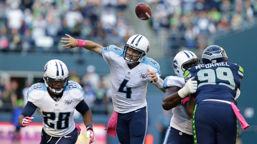 Tennessee Titans quarterback Ryan Fitzpatrick fumbles as he attempts a pass under pressure from Seattle Seahawks' Tony McDaniel (99) in the second half of an NFL football game, Sunday, Oct. 13, 2013, in Seattle. (AP Photo/Elaine Thompson)