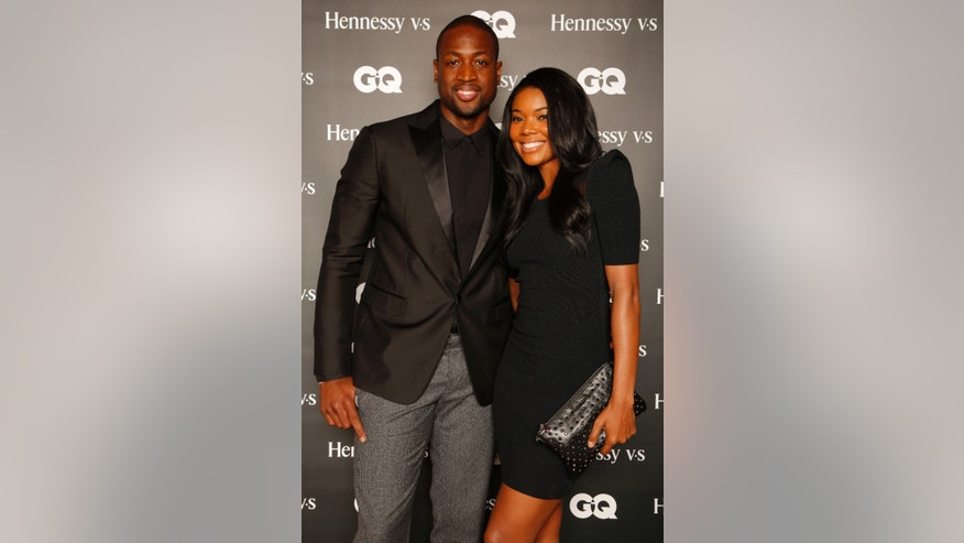 "Miami Heat's Dwyane Wade and Gabrielle Union attend the ""Hennessy V.S Celebrates the GQ MEN Book"" at Hyde Beach at the SLS Hotel South Beach on Saturday, Oct. 12, 2013 in Miami Beach, Fl. (Photo by Omar Vega/Invision/AP)"